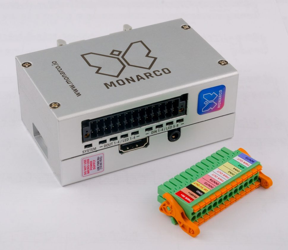 Monarco HAT and Raspberry Pi in a DIN-rail enclosure. Horizontal, connector detached.