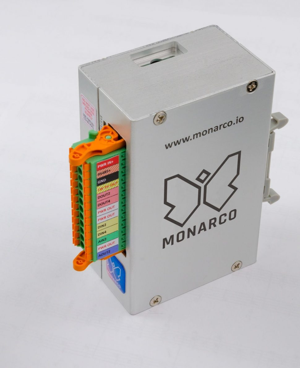 Monarco HAT and Raspberry Pi in a DIN-rail enclosure. Vertical, with connector.