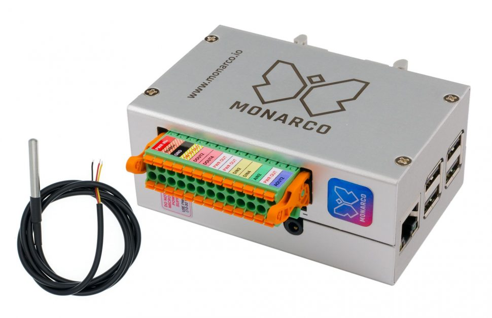 Monarco HAT and Raspberry Pi in a DIN-rail enclosure. Horizontal, with connector and temperature probe.